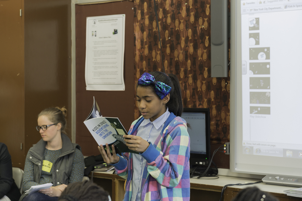 This young lady with the pretty bow, bravely read her piece to the students and parents in attendance. The students all did a wonderful job on this book. The parents and teachers should be proud of all the hard work the kids put into there book. More importantly the kids should be proud of the fact that they are now published writers.