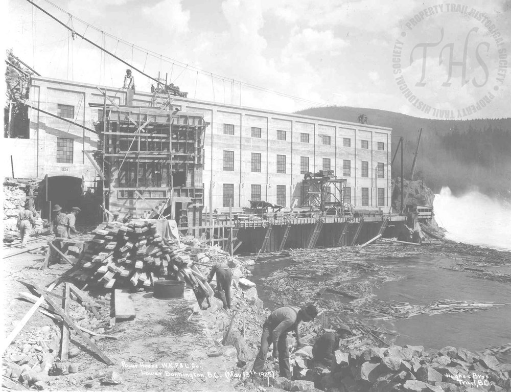 Lower Bonnington Powerhouse during reconstruction phase, workmen in foreground (Hughes) - 1925