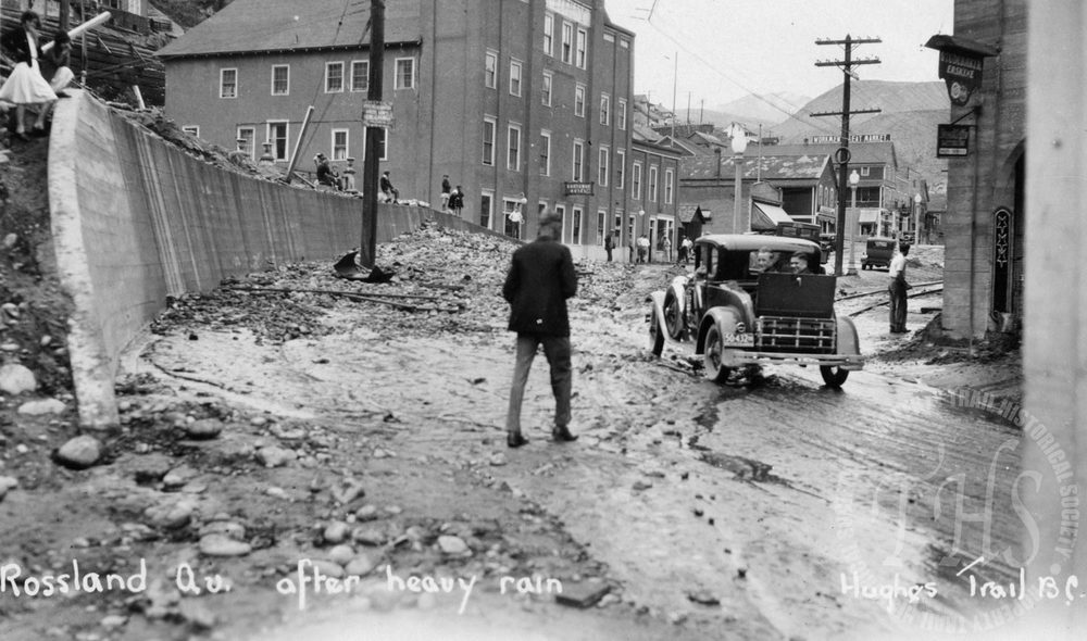 After heavy rain on Rossland Avenue, Kootenay Hotel in background (Hughes) - 1932