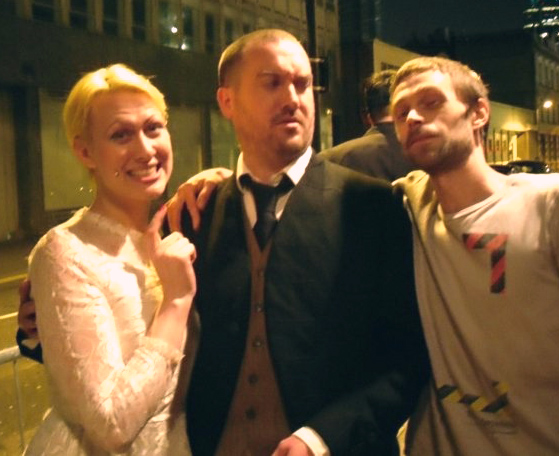 Ulysses Black and Sarah X. Delmonte, employed to impersonate newly weds on the door of a huge wedding reception in London allowing the actual wedding couple (groom featured right) to mingle at their leisure. 2009(ish)