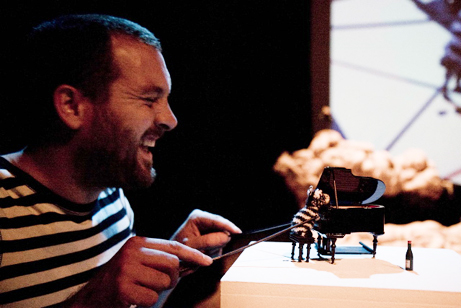 Ulysses Black Plays Minature Jazz Piano Zebra (with live-feed projection behind) in Annie Brooks' Colossal Crumbs. 2009.