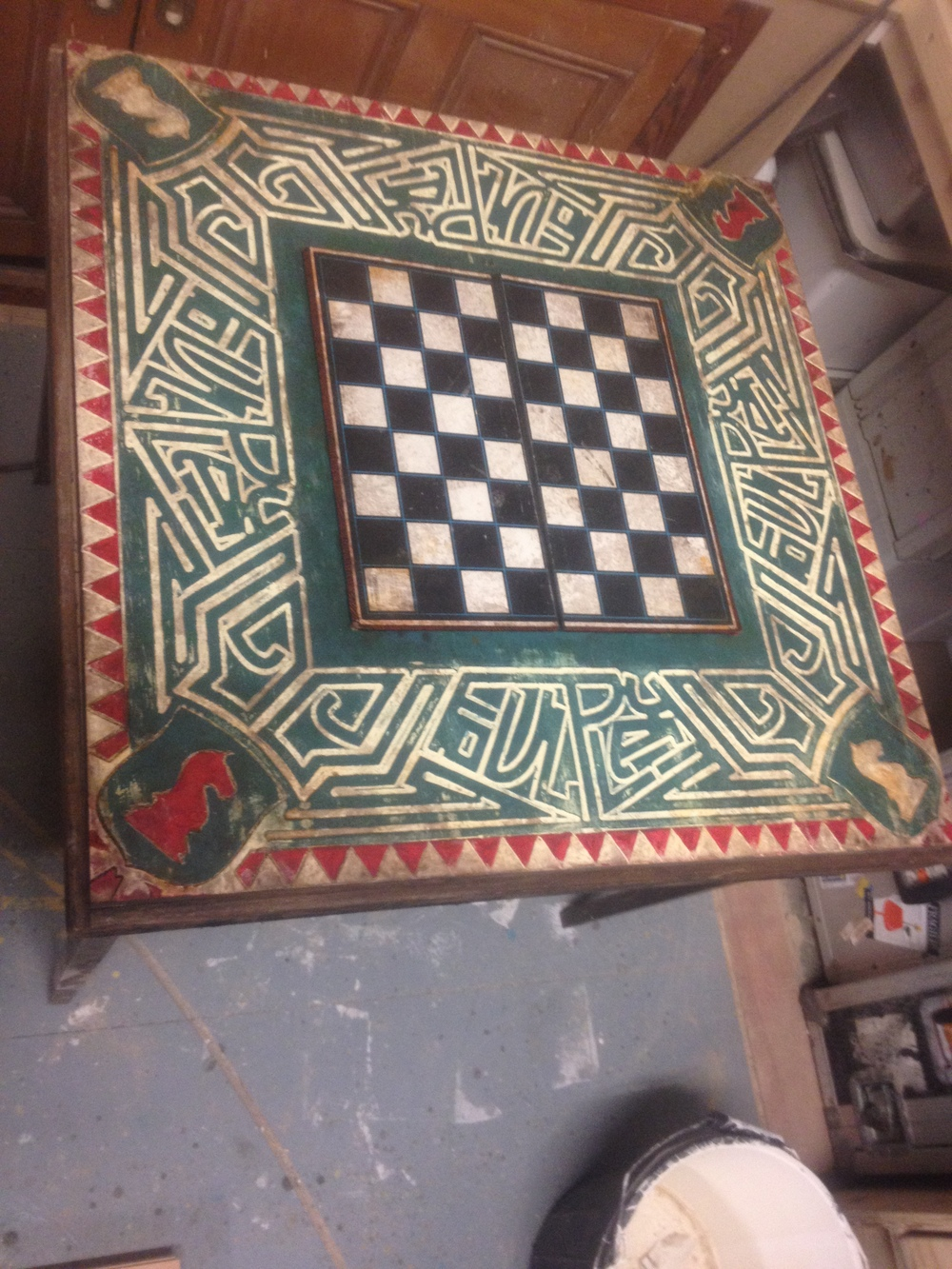 The deliciously decadent FoulPlay Chess Table carved into 7-ply by Tandem Set & Scenery, decorated by Jack Stigner and designed by Ulysses Black