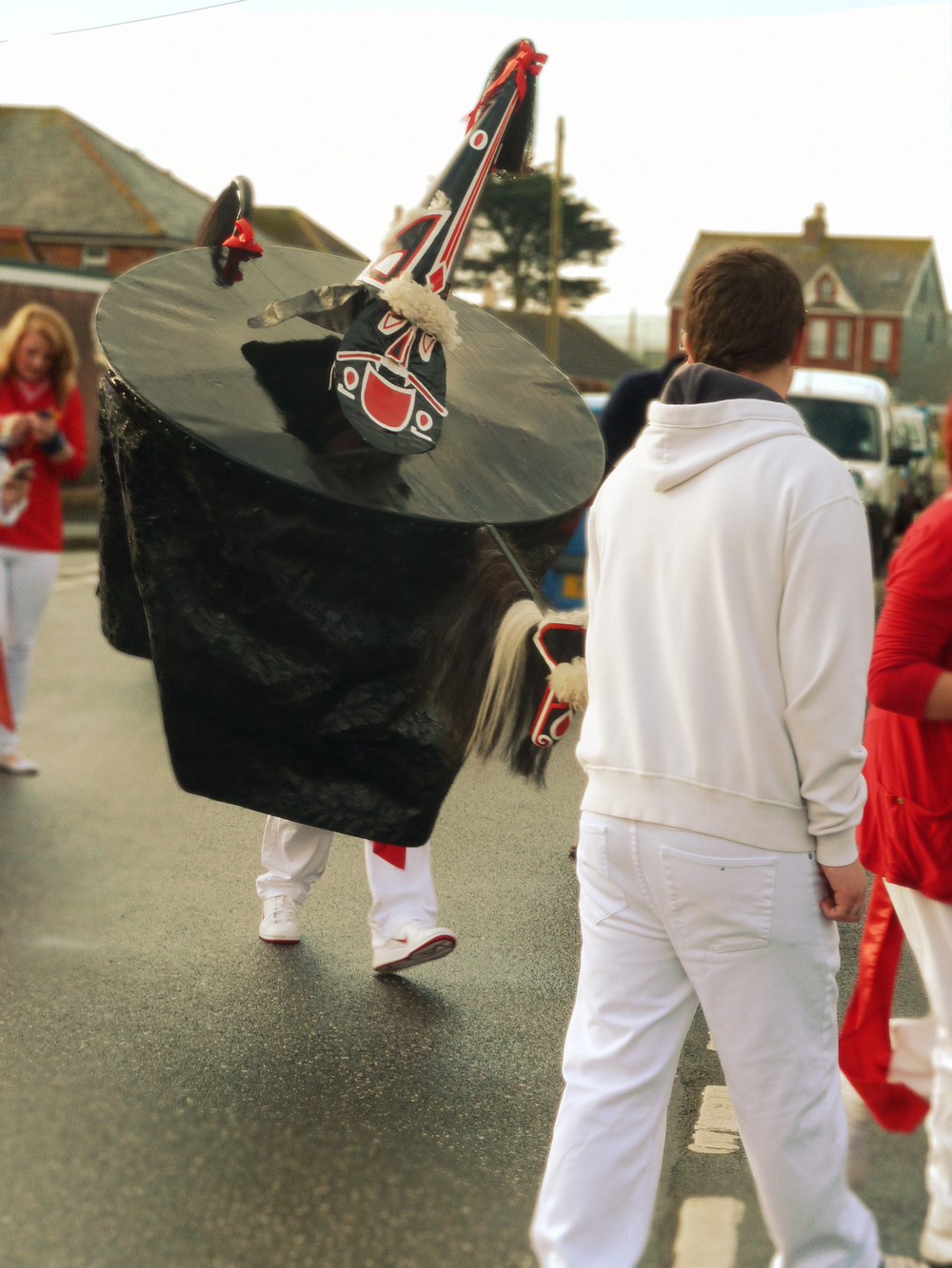 The Old Oss out for the Children's parade at dawn (around 6am). There is no word of irony or humour in the presence of the red and white Nike trainers, but rather demonstration of the degree of dedication to which the participants approach this festival.