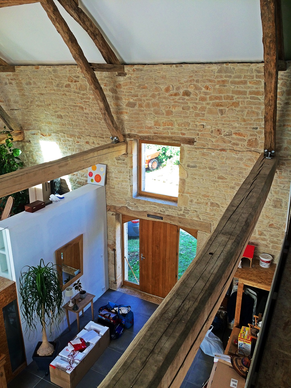 The existing roof timbers and stone walling are offset by contemporary insertions