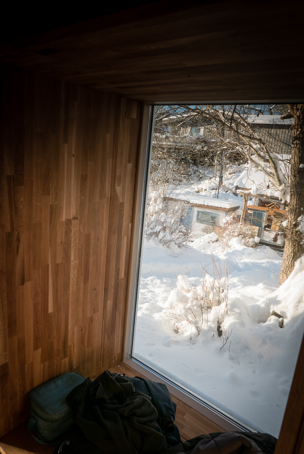 From the window niche in the play area, overlooking the snowy approach and the existing annex cabins