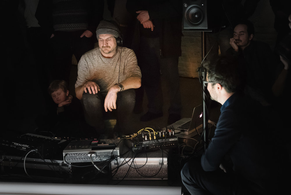 Musician Olivier Durteste (left) composing a live soundscape, as I (right) recompose the digital collage projected on the paper canvas in front of him.