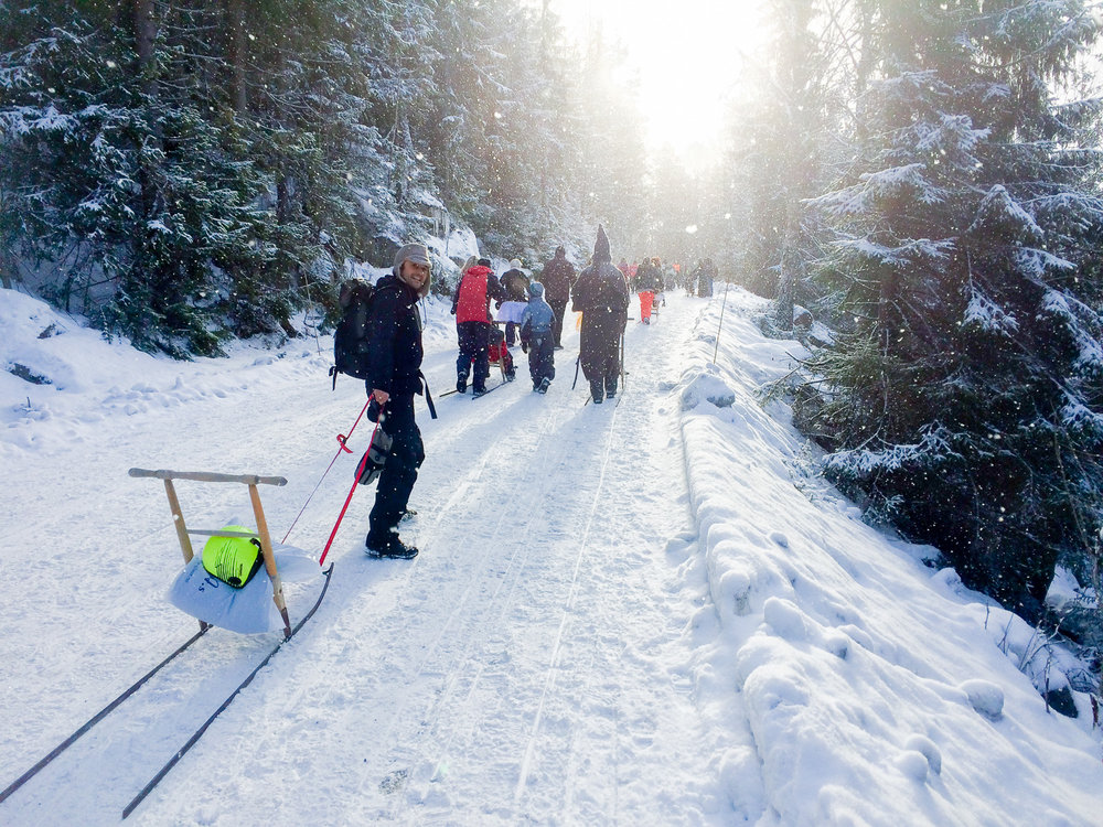 Hauling our finely tuned Spark up the mountain to the start line. Sun, snow and men dressed as wizards.