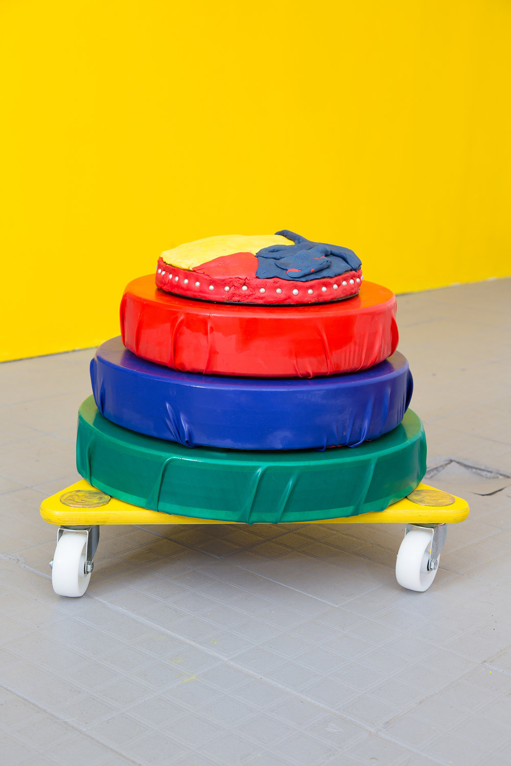 RGB Yellowcake 4/4   Materials: Ocean drums with ball bearings (internal), wooden moving trolley, latex, spray paint, gouache and acrylic paint, vanilla cake, yellow food colouring, silver sugar pearls, fondant     Mobile sculpture dimensions: 1.5 metre x 1 metre