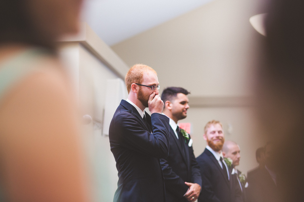 Groom-crying-during-wedding