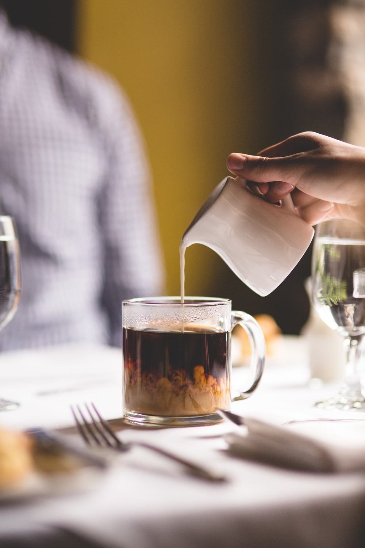 poruing-creme-into-clear-coffee-mug
