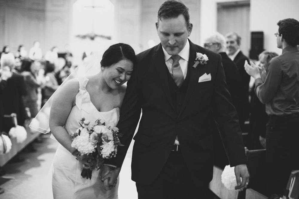 cure-bride-and-groom-walking-down-isle-ottawa