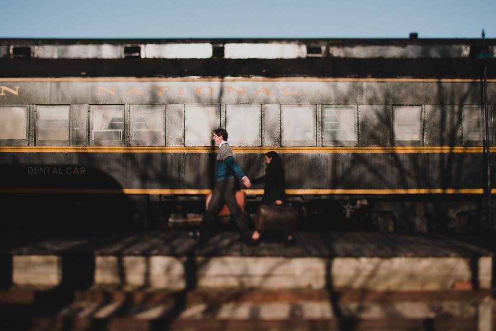 couple walking along train platform