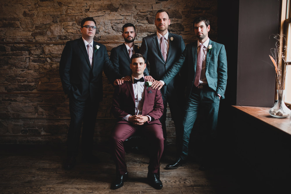 Multicoloured groomsmen suits