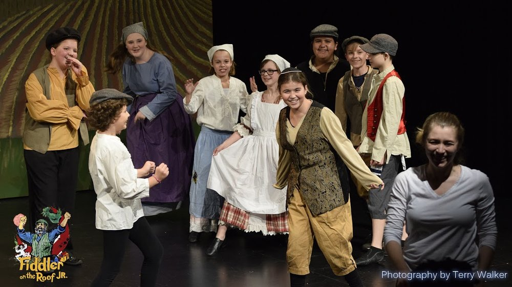 Some of the cast of 2017's Fiddler on the Roof Jr. - with Music Director Olga Denisova