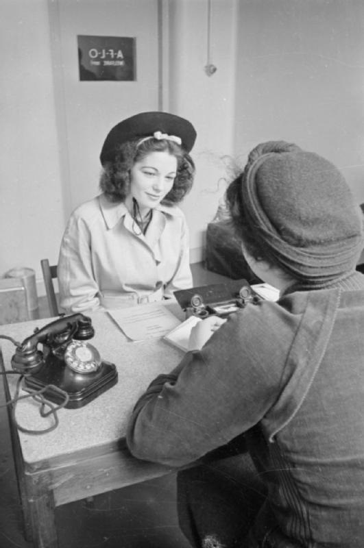 Upon volunteering for war work, this woman is being interviewed by a member of the Ministry of Supply Welfare Staff, to ensure that she is given the most suitable job in the factory. By Ministry of Information Photo Division Photographer [Public domain], via Wikimedia Commons