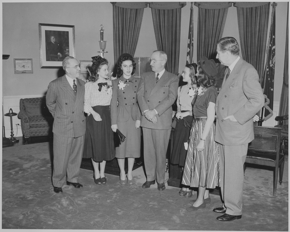President Truman greets winners of the Voice of Democracy contest. L to R: Dr. John W. Studebaker, Janet Gerster, Rose Mudd, President Truman, Alice Tyree, Laura Shatta, and Sen. James Murray.