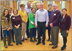 Staff and employers posed for a photo at the thank you breakfast. From left are Angie Hartline, Mary Pat Thompson, Annette DiZinno and Laurie Brandenburg of Harrigan Development, Roger Erickson of From Scratch Catering, Ellen McKay,Teri Zahour and Andy Harrigan of Harrigan Development, Tina Carroll of Crossroads Presbyterian Church, Bob Pipes of Harrigan Development and Peggy Boris of Richmond Investments.