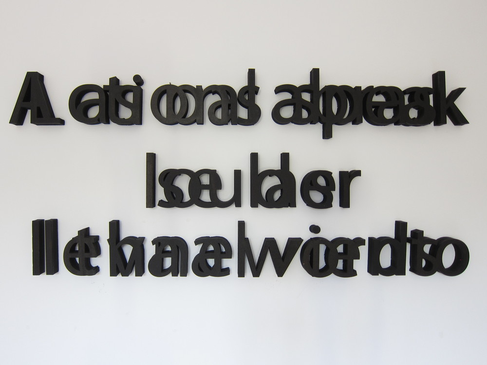 'Untitleable' - Installation  /Laser cut MDF Approx. 130 x 11 x 5 cm - Sayings in English and Spanish superimposed