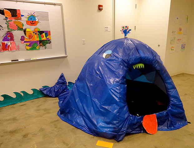 "A tent transformed into an open-mouthed whale during the ""Belly of a Whale"" ART BRAINS project at Artisphere. The students filled the whale's belly with cut-out drawings of objects and creatures they imagined the whale had swallowed.  Click here to read more about this project."