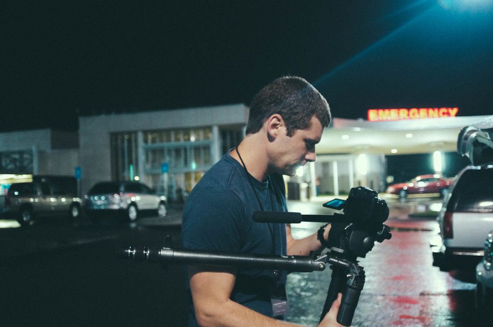 Jonathan filming the process of a victim advocate.