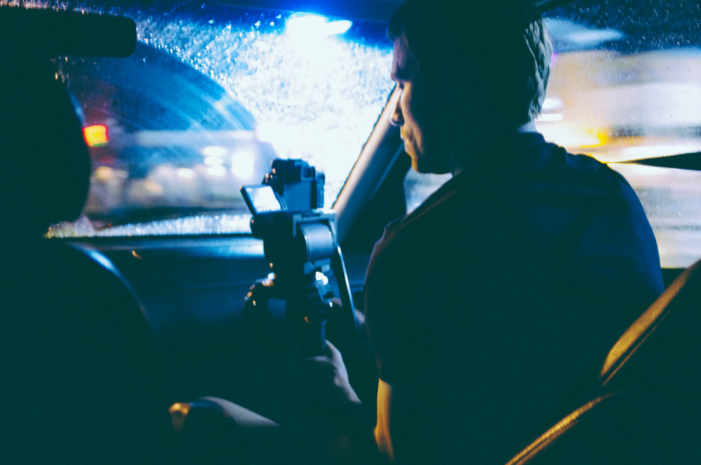Christopher filming a victim advocate on the way to a hospital.