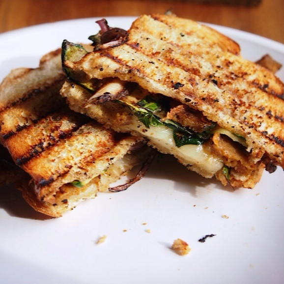 Curried seitan panini with slivered collard greens, red onion, grilled ...