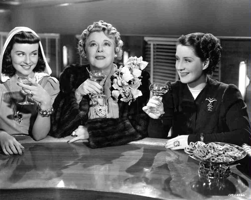 "On the train to Reno with Paulette Goddard, Mary Boland and Norma Shearer. ""L'amour, L'amour!"""