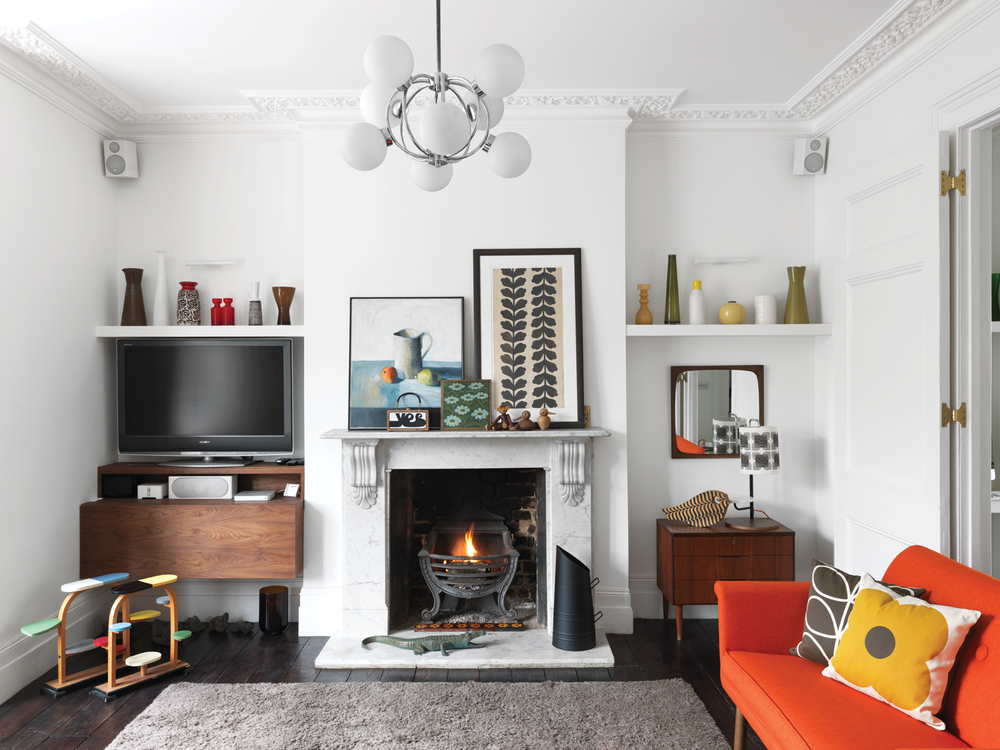 In the living room, salvaged ebony wood flooring and pops of citrus.