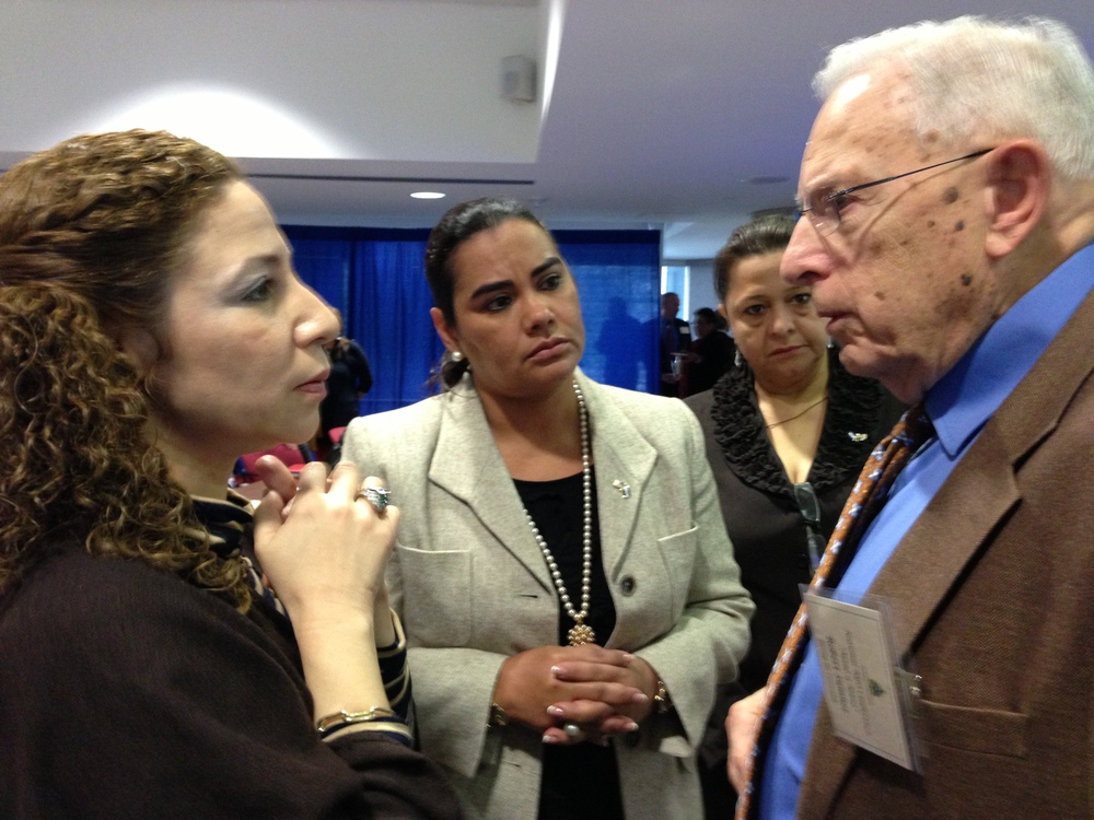 First Lady of Honduras Rosa Elena Bonilla de Lobo (center) and Vice Secretary of Social Development Lidia Fromm Cea (left) listen to Bob Sumner describe the challenges SATC has faced recently in shipping medical equipment and supplies to the Manos Amigas clinic. Both have already taken positive action to help.