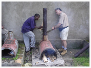 Tanzania fix water heater chimney.jpg