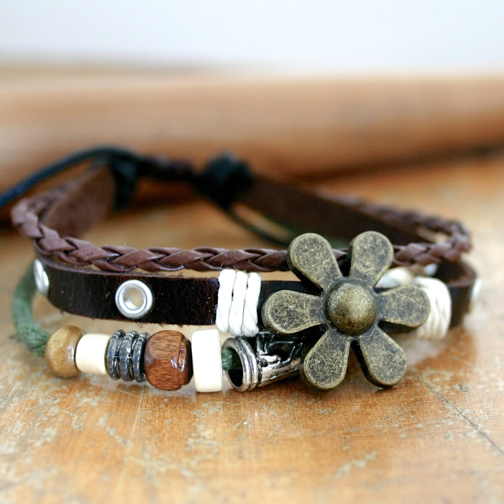 Leather and Flower adjustable bracelet. $14.99