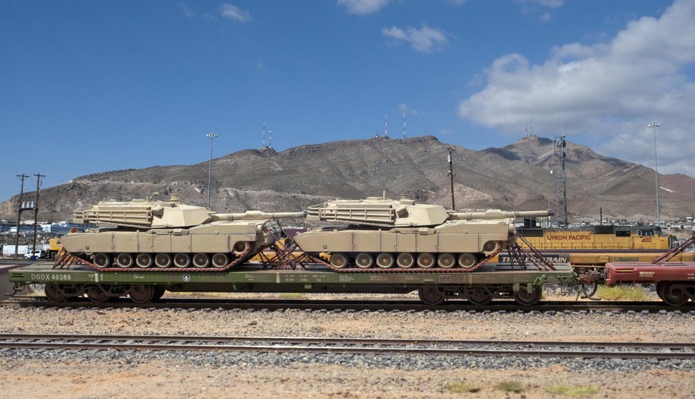 A UTI Models 40000 series flat car with Alkem Scale Models tie down chains. This model was an imported brass model that is sold out, but some may be available via auction sites.
