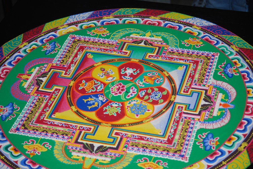 Tibetan Sand Mandala invoking the Buddha of Compassion, by the Drepung Loseling Monks of South India, Portland Public Library, Portland, OR   Photo by Megan Swindro