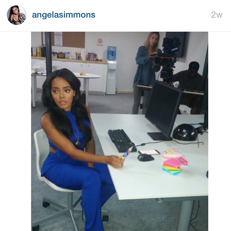 Angela Simmons wears the Electric Shock Jumper on set