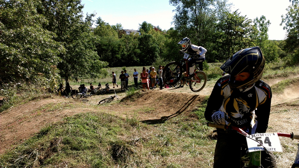 Andy looks on as another rider gets crazy air during the Dual Slalom at our home race fall 2012.