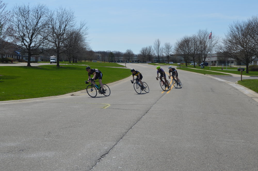 Henry Gentle leads the breakaway through a turn at the University of Michigan Criterium
