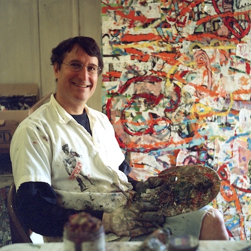 Playwright Tom Block with his paintings.