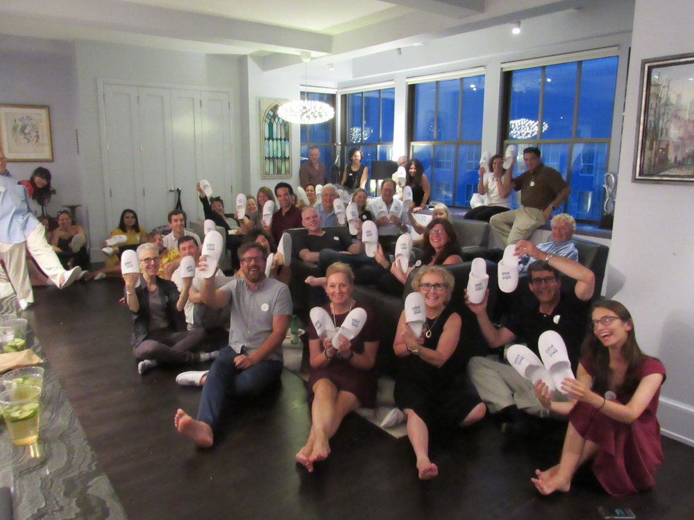 All the guests show off their JPP slippers in Yuval's gorgeous apartment.