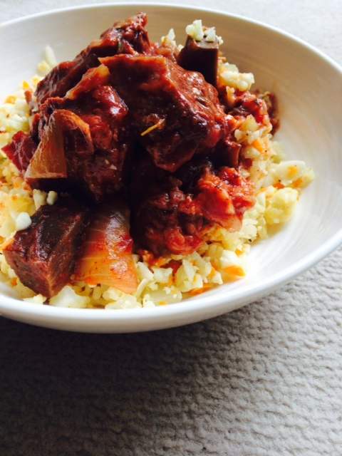 Braised beef and bacon in a red wine sauce served with cauliflower 'rice'