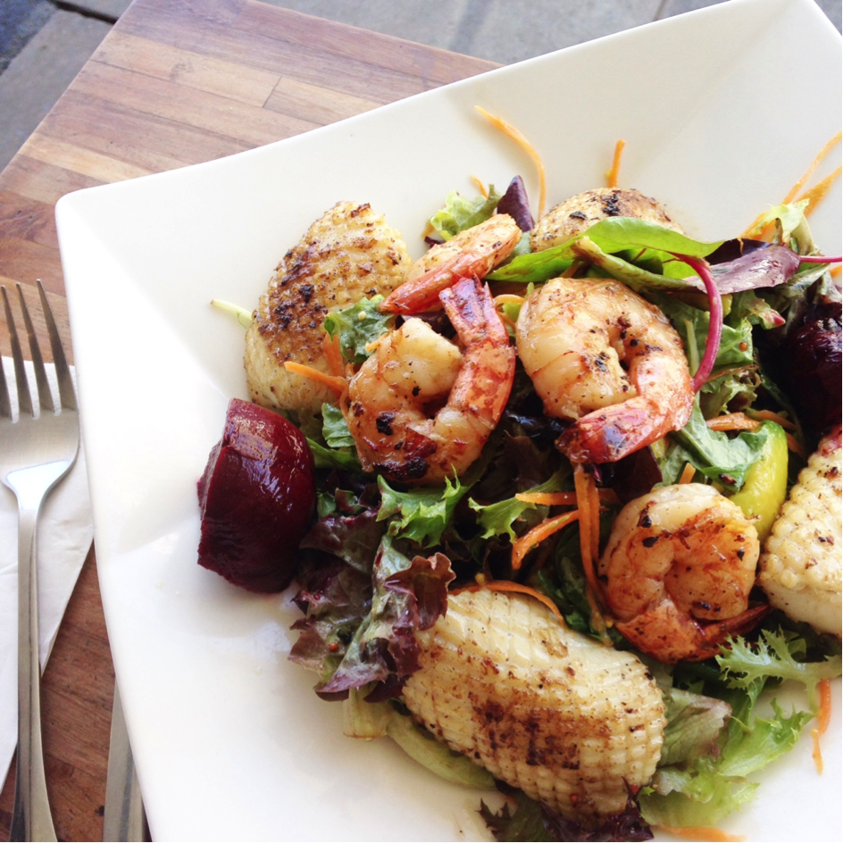 Chargrilled Prawn and Squid Salad with apple infused beetroot, avocado, mesclun and lemon thyme vinaigrette.