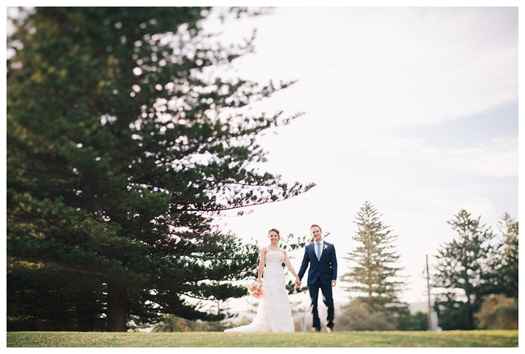 palm beach wedding couple with tree