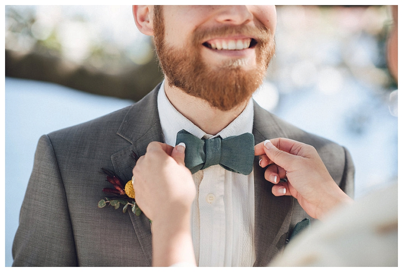 groom's suit and bowtie