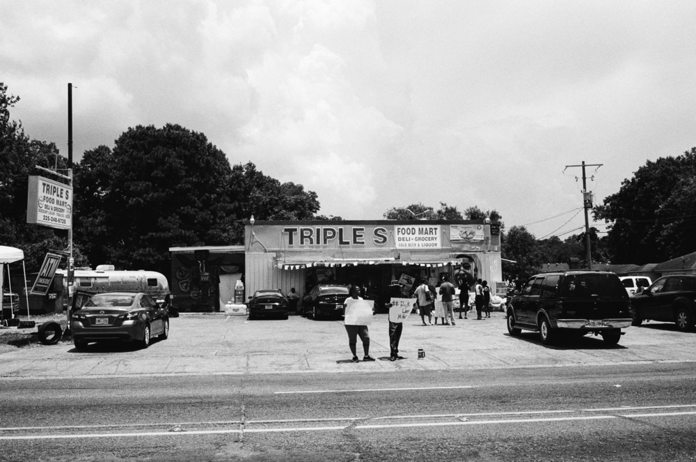 The Triple S Food Mart becomes a pilgrimage spot and a locus for protest.