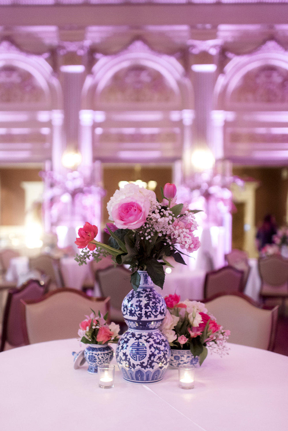 """ The flowers with the ginger jars definitely exceeded my vision tying in the blue and pink inspiration. Our team of vendors fully executed this!"" -Bride, Carly"