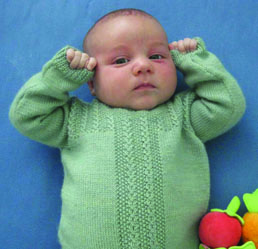 2d96f7726c2681 The sweater is knit in pieces and seamed together