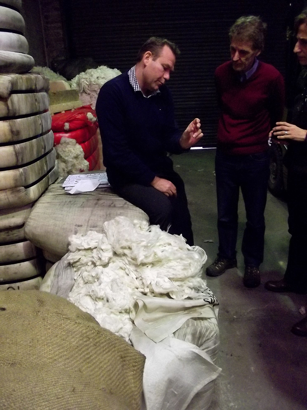 The wool comes in raw and is inspected for quality several times.