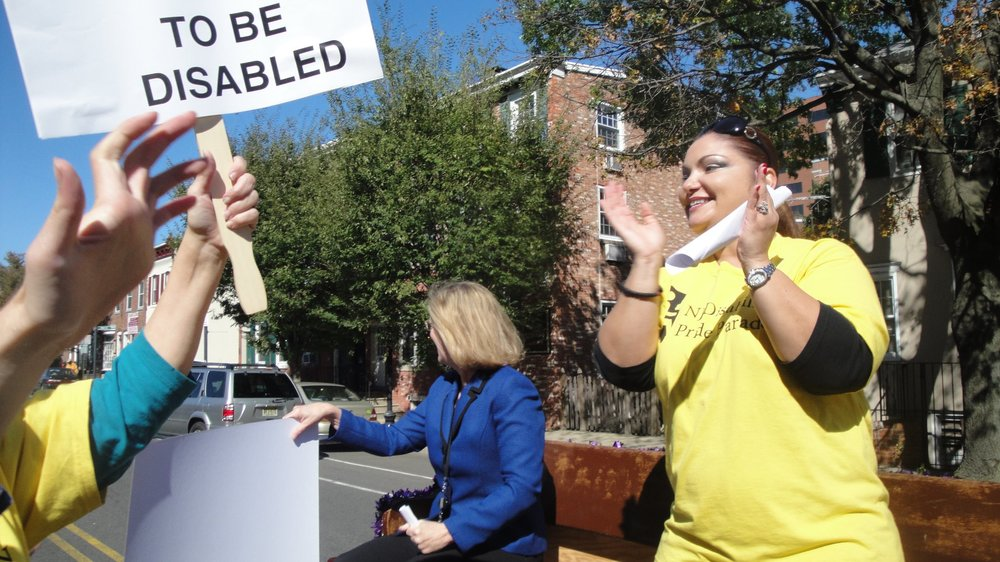 Alice Hunnicutt (of DVRS) and Maria on the NJ Disability Pride Parade float.
