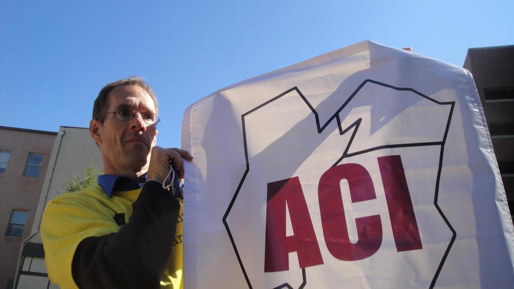 Luke holding ACI sign at NJ Disability Pride Parade 2011.