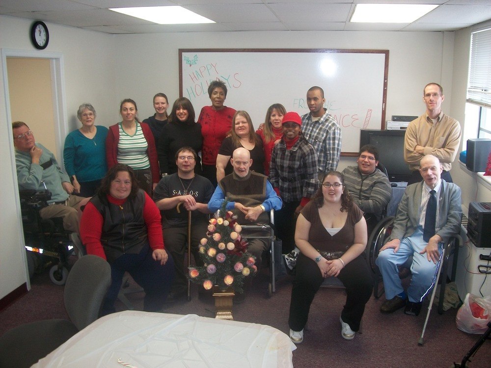 Staff and volunteers celebrate the Holidays.
