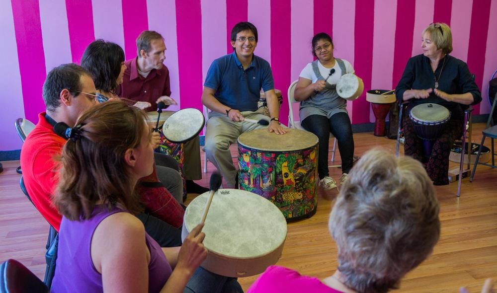 Julie Bunucci facilitates a drum circle for ACI staff and volunteers.